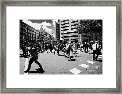 People Walking Across Busy Pedestrian Crossing Placa De Catalunya Barcelona Catalonia Spain Framed Print by Joe Fox