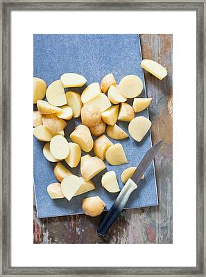 Potatoes Framed Print by Tom Gowanlock