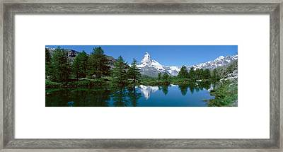 Reflection Of A Mountain In A Lake Framed Print by Panoramic Images