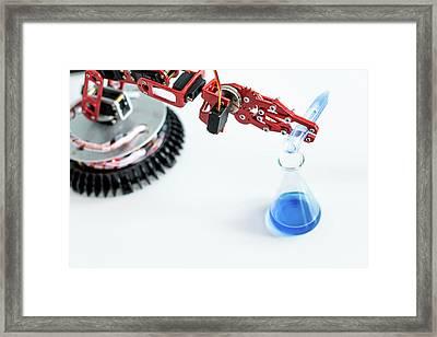 Robotic Arm Pouring Chemical Framed Print by Wladimir Bulgar