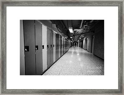 row of locked school lockers in empty corridor of High school canada north america Framed Print by Joe Fox