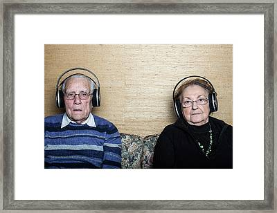 Senior Couple Wearing Headphones Framed Print by Mauro Fermariello