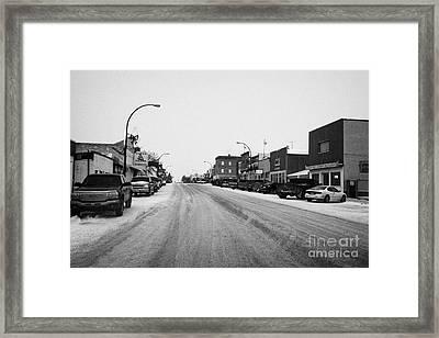 shops and stores on the main street Biggar Saskatchewan Canada in winter Framed Print