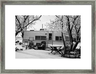 small trailer mobile home covered in snow in rural village of Forget Saskatchewan Canada Framed Print