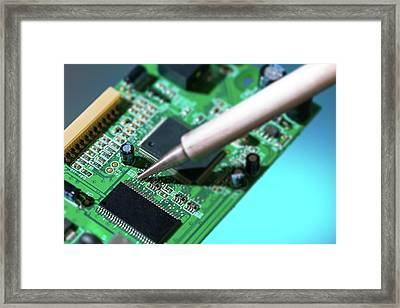 Soldering An Circuit Board Framed Print by Wladimir Bulgar