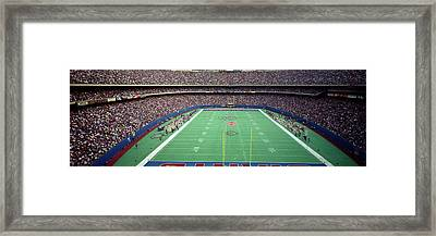 Spectators Watching A Football Match Framed Print by Panoramic Images