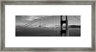 Suspension Bridge With A City Framed Print