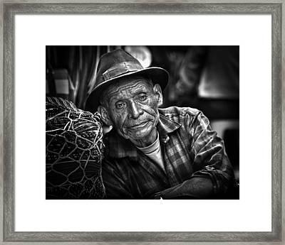 Textile Merchant Framed Print by Tom Bell