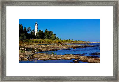 The Cana Island Lighthouse In Baileys Harbor Reflective Waters. Framed Print by Carol Toepke
