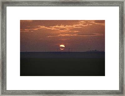 The Setting Sun In The Distance With Clouds Framed Print