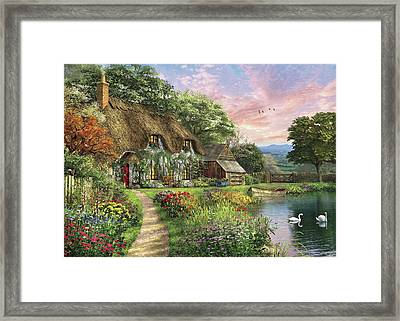 The Sunset Cottage Framed Print