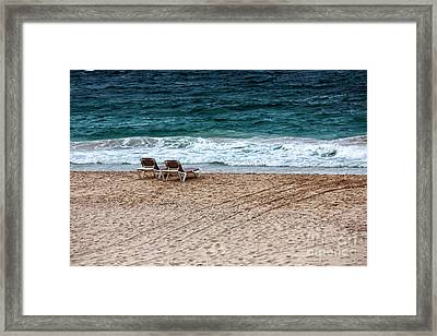Waiting For Two Framed Print by John Rizzuto