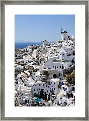 Windmills And White Houses In Oia Framed Print by George Atsametakis