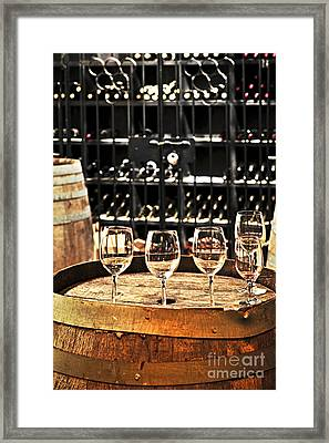 Wine Glasses And Barrels Framed Print by Elena Elisseeva