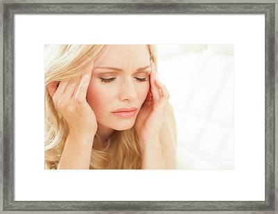 Woman Touching Head Framed Print