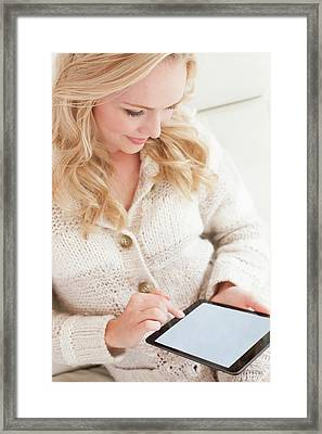 Woman Using Digital Tablet Framed Print