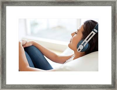 Woman Wearing Headphones Framed Print
