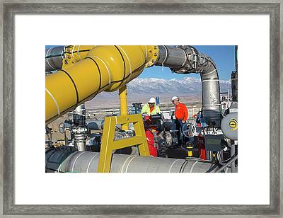 Workers Inspecting Water Pumps Framed Print by Jim West