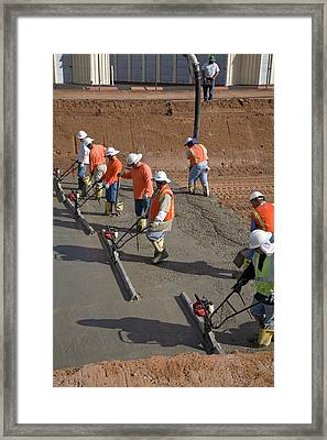 Workers Lining A Canal With Concrete Framed Print by Jim West