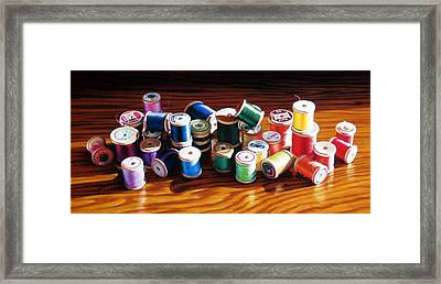 30 Wooden Spools Framed Print by Dianna Ponting