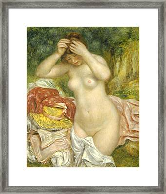 Bather Arranging Her Hair Framed Print by Pierre Auguste Renoir