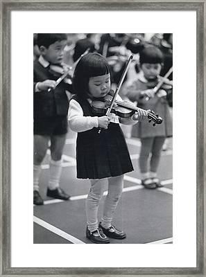 Little Fiddlers Make Big Music Framed Print by Retro Images Archive