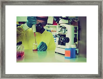 Scientist In Hazmat Suit Framed Print