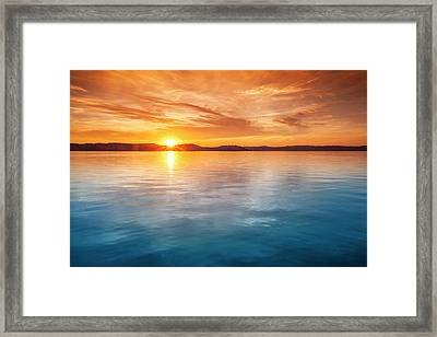 Sunset Over Water Framed Print by Focusstock