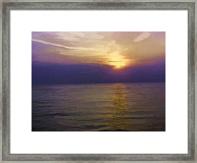 View Of Sunset Through Clouds Framed Print