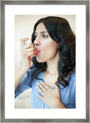 Woman Using Inhaler Framed Print by Ian Hooton