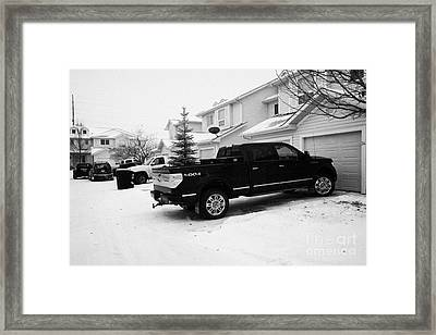 4x4 Pickup Trucks Parked In Driveway In Snow Covered Residential Street During Winter Saskatoon Sask Framed Print