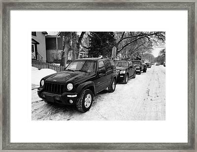 4x4s Trucks And Suvs Parked Onstreet During Winter Caswell Hill Saskatoon Saskatchewan Canada Framed Print by Joe Fox