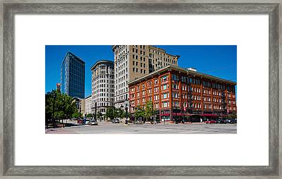 Buildings In A Downtown District Framed Print