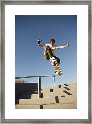 Low Angle View Of Young Male Framed Print