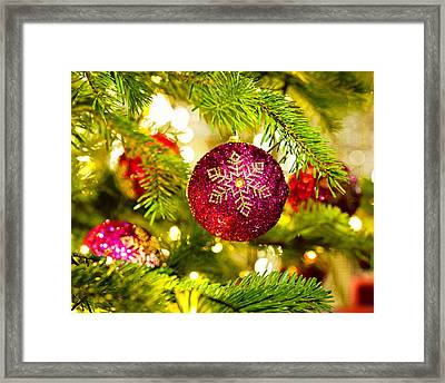 Ornament In A Christmas Tree Framed Print by Ulrich Schade