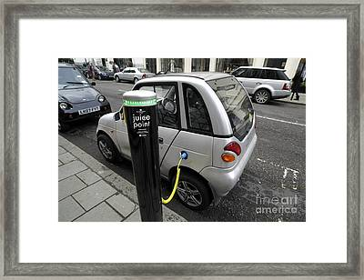 Recharging An Electric Car Framed Print by Martin Bond