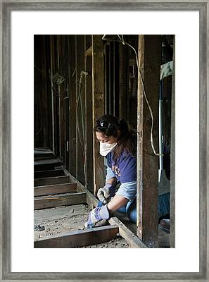 Repairing Flood Damage Framed Print