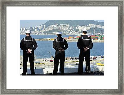 Sailors Man The Rails Aboard Framed Print by Stocktrek Images