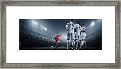Soccer Player Kicking Ball In Stadium Framed Print by Dmytro Aksonov
