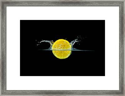 Splashing Lemon Framed Print by Peter Lakomy