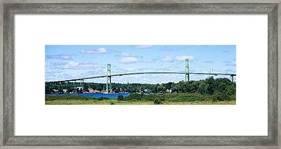 Suspension Bridge Across A River Framed Print