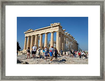 Tourists In Acropolis Of Athens In Greece Framed Print by George Atsametakis