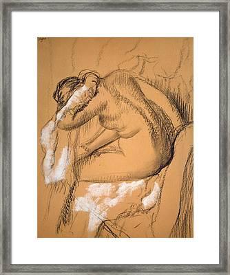 Woman Drying Herself  Framed Print by Edgar Degas