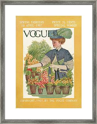 A Vintage Vogue Cover Of A Woman Gardening Framed Print by Artist Unknown