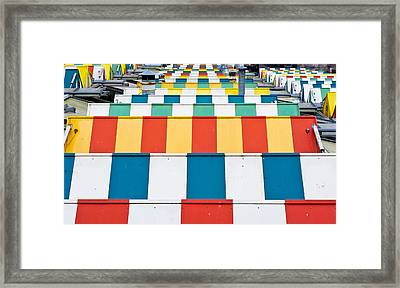 Colorful Roofs Framed Print by Tom Gowanlock