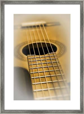 6 Golden Strings Framed Print