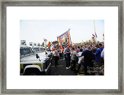 Loyalist Protesters Attack Police Lines Framed Print by Andrew Chittock