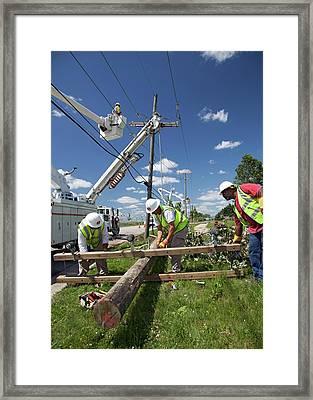 Repairing Power Lines Framed Print by Jim West