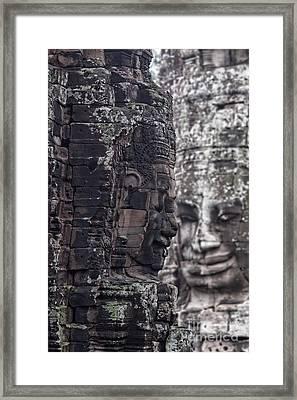 Smiling Faces Of Bayon Framed Print by Joerg Lingnau