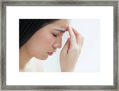 Woman Touching Head Framed Print